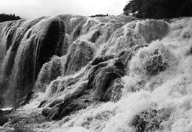 Water is floating on a waterfall. In black and white royalty free stock photography