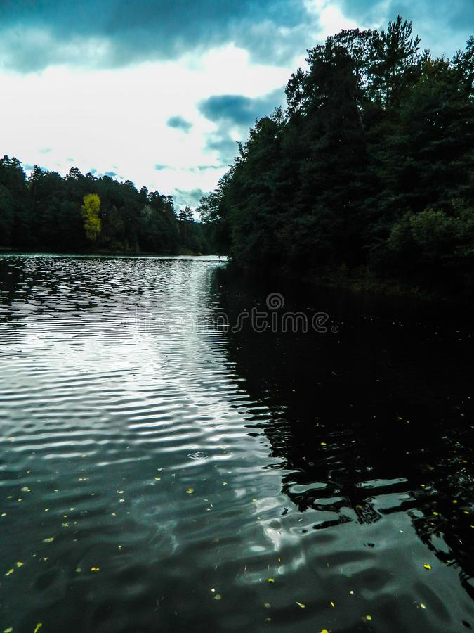 The water flow of the river. Fast flowing rivers are picturesque, and the abundance of vegetation on the banks. The water flow in the shots looks very royalty free stock photography