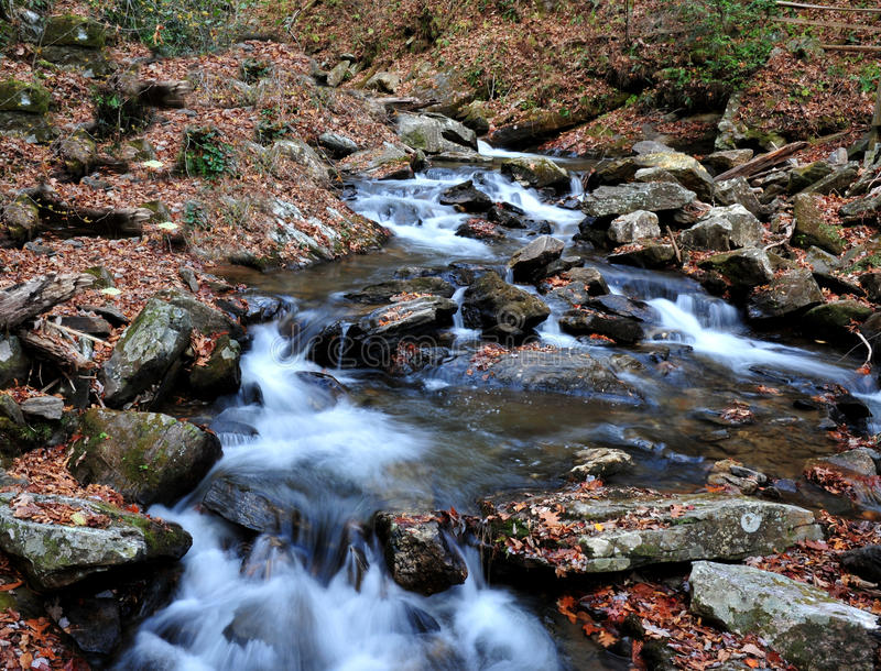 Water flowing down the river stock image