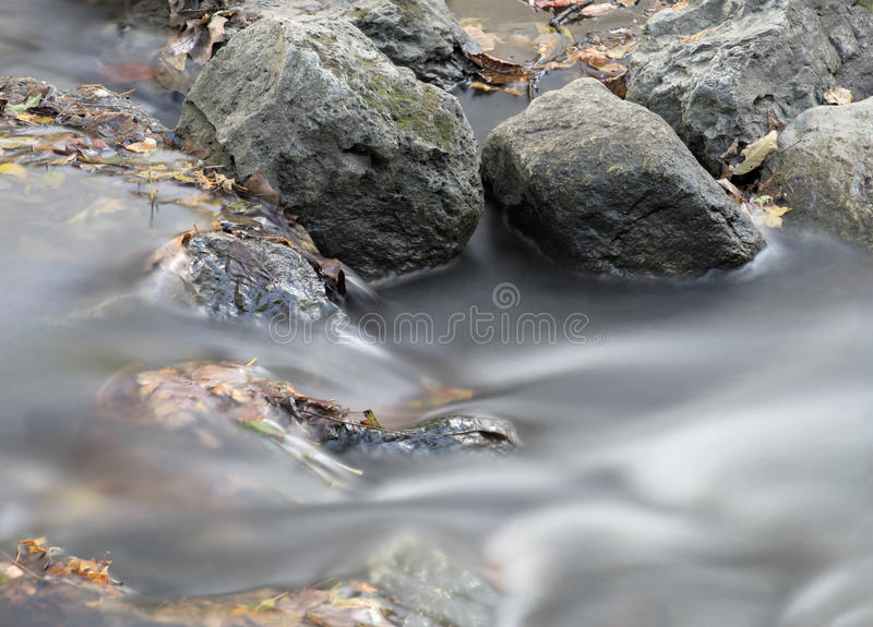 Water flowing over rocks royalty free stock images