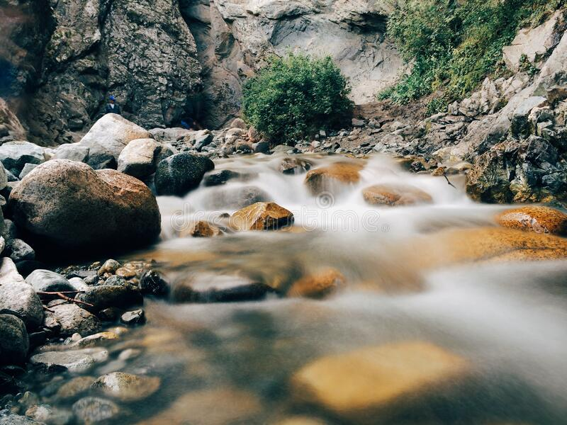 Water flowing over stones in creek stock photography