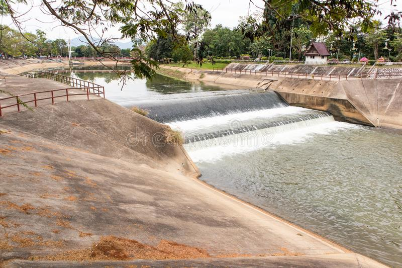 Water flowing from small dam. In Thailand stock photos