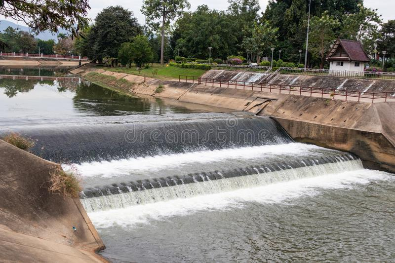Water flowing from small dam. In thailand stock images