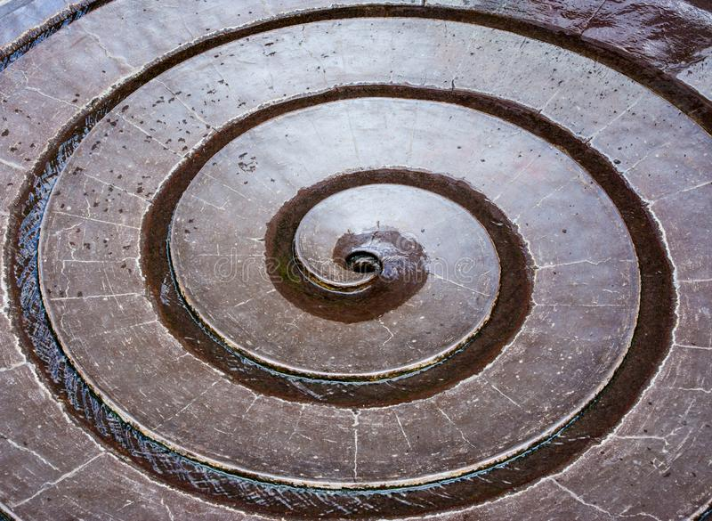 Water flowing in a sprial fountain stock image