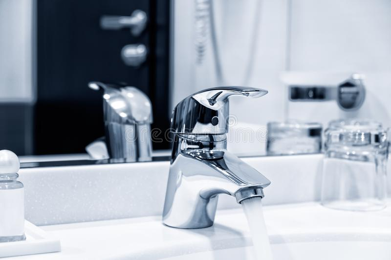 Water Flowing From The Tap stock photo