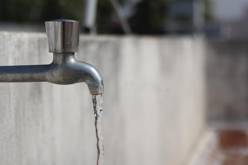 Water flowing from tap stock images
