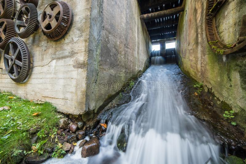 Water flowing under an old mill stock photos
