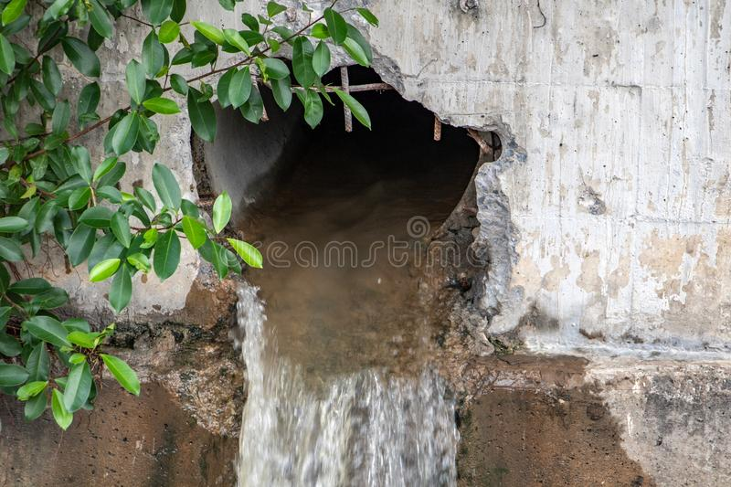 Water flows from a large hole in the wall royalty free stock photography