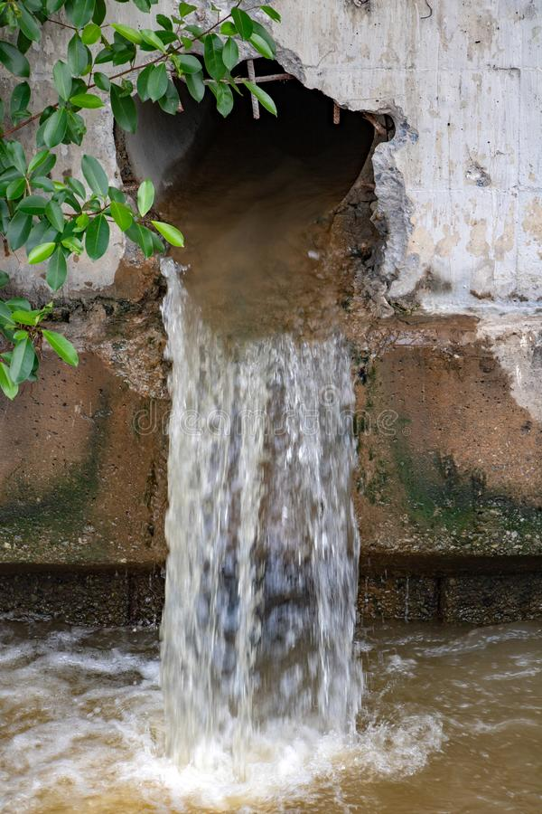 Water flows from a large hole in the wall stock photos