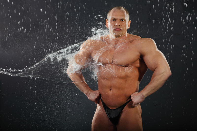 Download Water Flows On Undressed Bodybuilder Stock Image - Image: 22735949