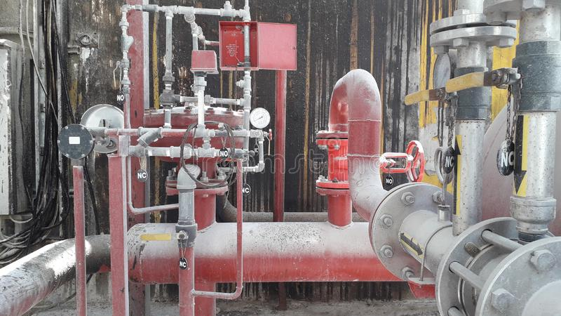 Water and foam equipment  for fire protection system in fuel oil storage stock image