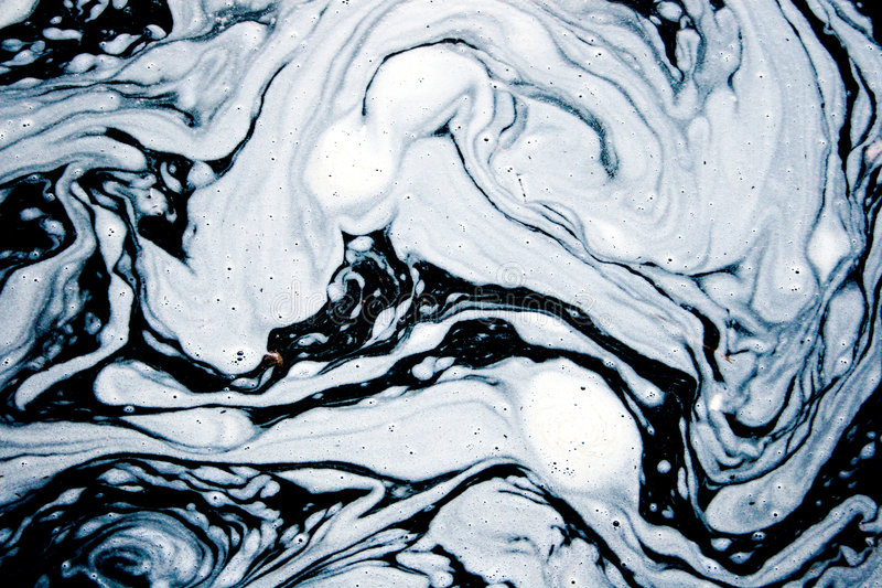 Water foam forming interesting patterns royalty free stock photography