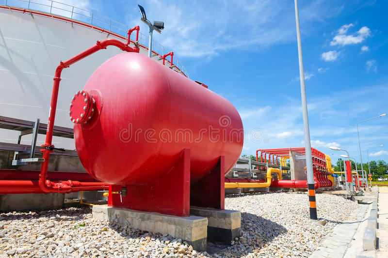 Water and foam line for fire protection system. In fuel oil storage tank stock photos