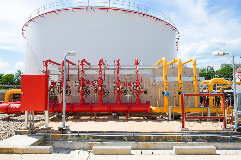 Water and foam line for fire protection system. In fuel oil storage tank area stock images