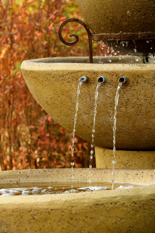 Water fountain. Consisting of three levels. Water running from the one level to the next level. These fountains are mainly used for decorative purposes in a royalty free stock image