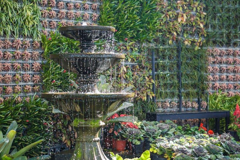 Water fountain botanic garden decoration. Antique water fountain botanic garden decoration stock photos