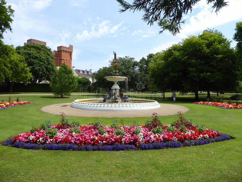 Water fountain and flower beds. The decorative Victorian water fountain and flower beds in Vivary Park in Taunton in Somerset, England stock photos