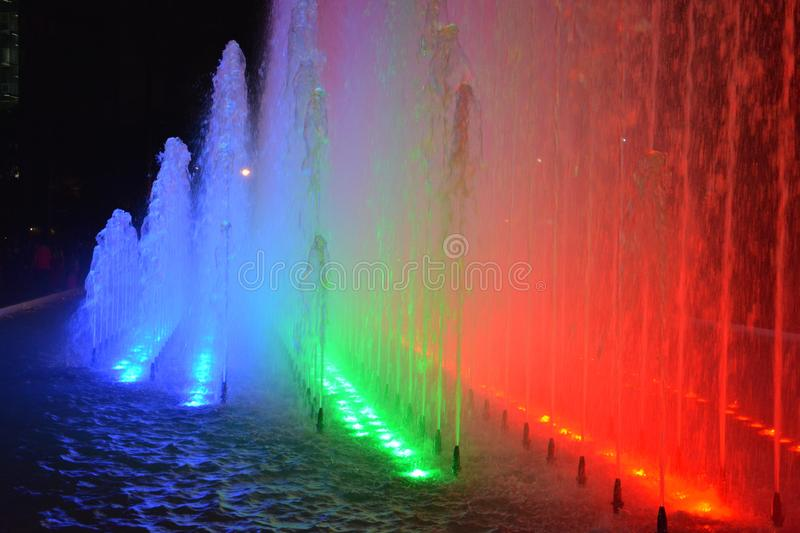 water fountain gives colorful show in lima peru stock photography