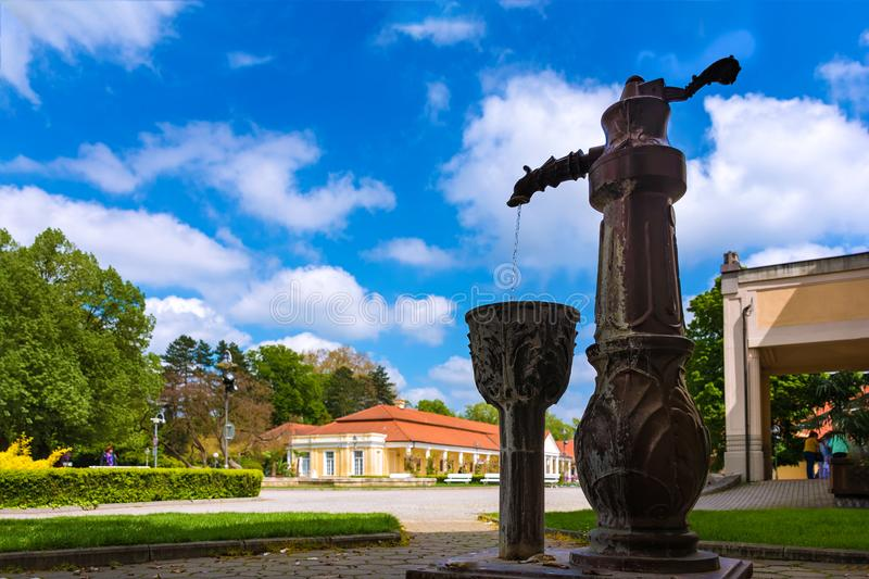 Water fountain and historical building on spa island in Piestany. SLOVAKIA royalty free stock photos