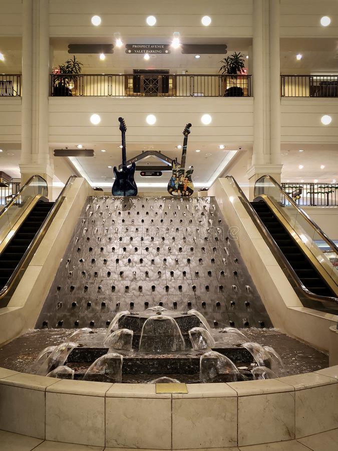 Water fountain inside Tower City Mall in Cleveland, Ohio. Guitar, artwork, stone, seating, escalator royalty free stock images