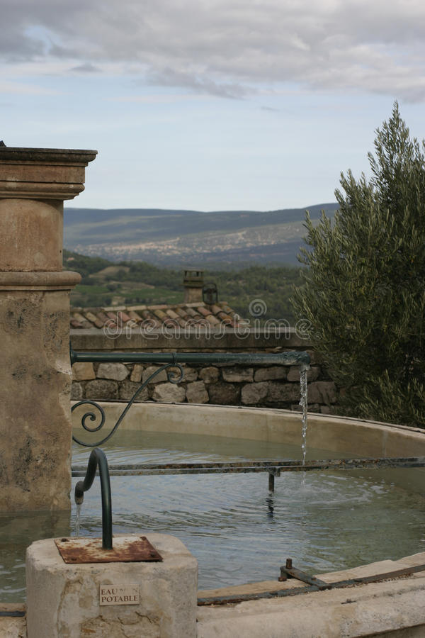 Water fountain in The Luberon in South West France. Ancient Water fountain in The Luberon in South West France. Rolling hills in the background stock photography