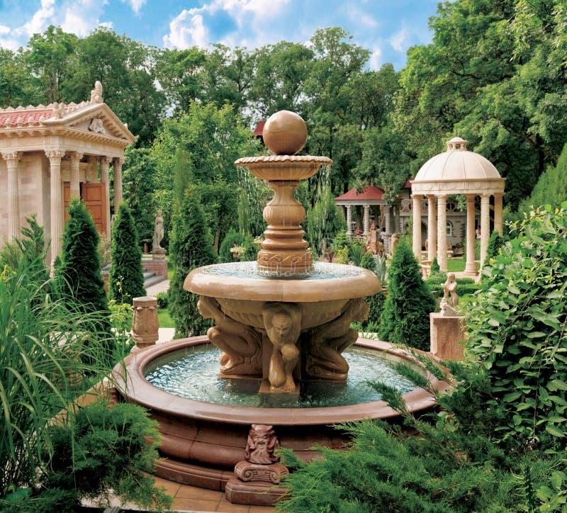 Water fountain in old park. Scenic view of decorative water fountain and structures in old park, Cabardinca, Gelendzhik, Krasnodar Krai, Russia stock image