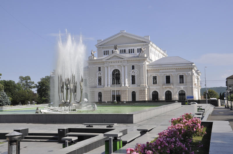 Water Fountain and Theater. In Drobeta Turnu-Severin in Romania in a sunny day of spring stock photography