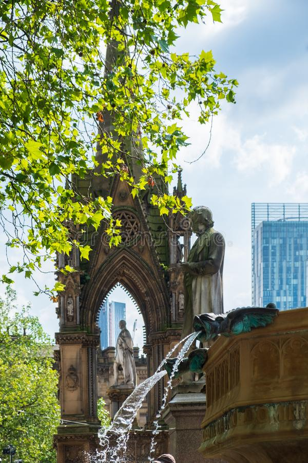Water fountains, John Bright Statue and Albert Memorial at the Manchester Town Hall in Manchester, United Kingdom. Manchester, United Kingdom - July 7, 2019 royalty free stock photography