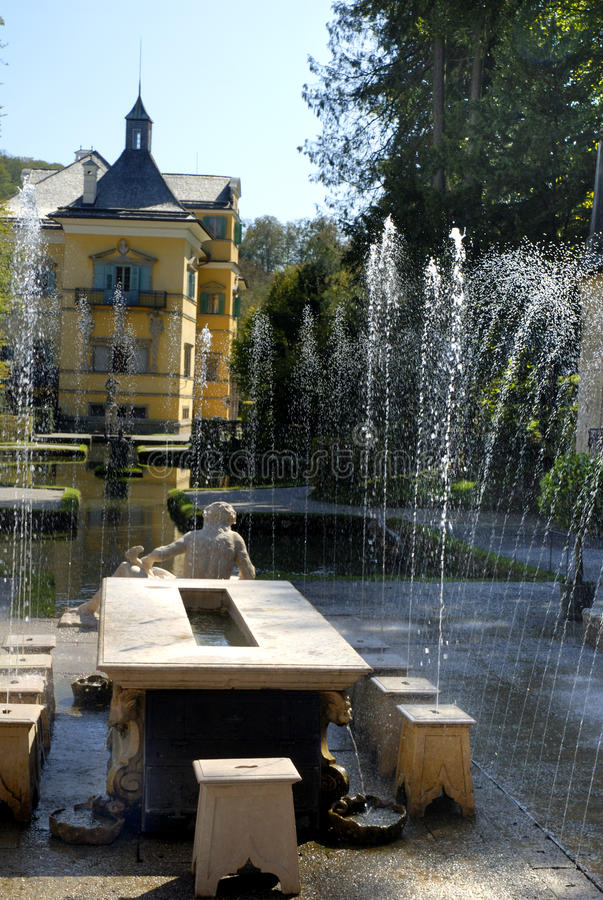 The Water Garden at the Castle of Hellbrunn in Salzburg in Austria with its many `trick` fountains. Hellbrunn is situated at Salzburg`s southern city limits. The royalty free stock image