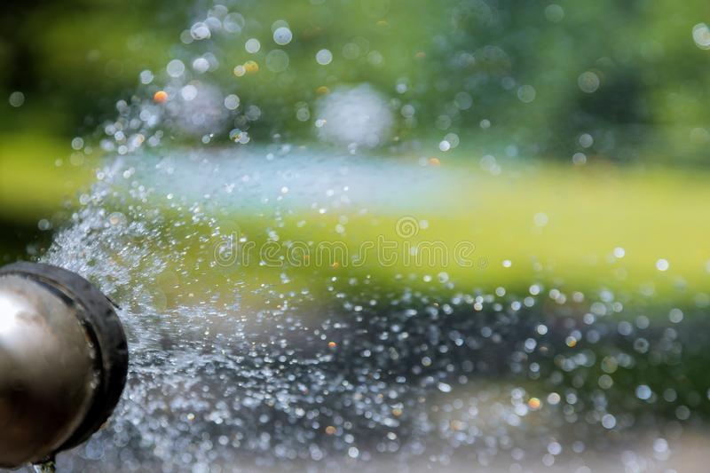 Water from a garden hose blurred water bokeh defocused. Water from a garden hose blurred abstract water bokeh defocused, nature, summer, sparkling, green, spray royalty free stock photos