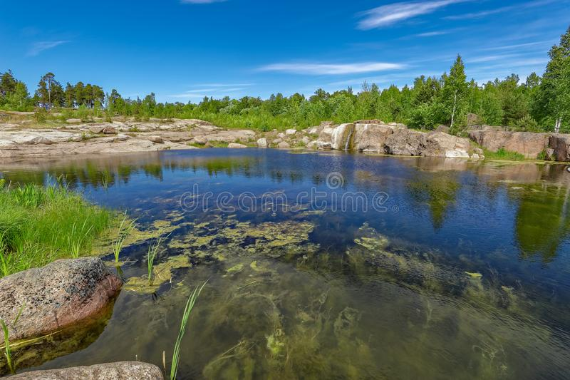Water garden with small waterfall integrated into the natural en stock images