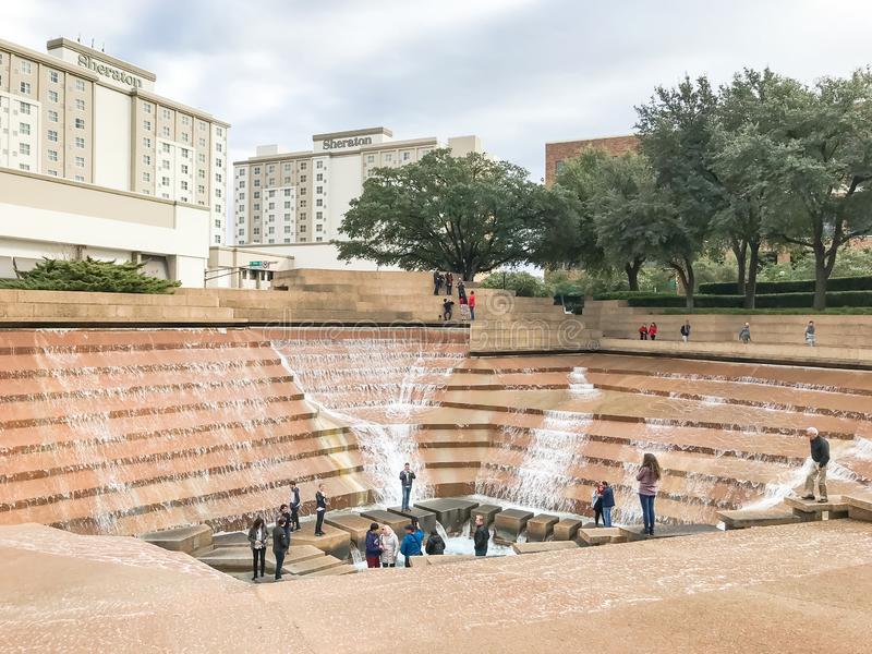Water Gardens in downtown Fort Worth with visitors. FORT WORTH, TX, US-DEC 24, 2018:Water Gardens in downtown Fort Worth with visitors. A beautiful and royalty free stock photo