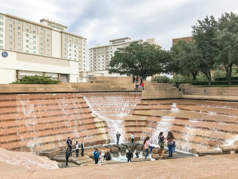 Water Gardens in downtown Fort Worth with visitors. FORT WORTH, TX, US-DEC 24, 2018:Water Gardens in downtown Fort Worth with visitors. A beautiful and stock photo