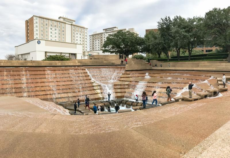 Water Gardens in downtown Fort Worth with visitors. FORT WORTH, TX, US-DEC 24, 2018:Water Gardens in downtown Fort Worth with visitors. A beautiful and stock photos