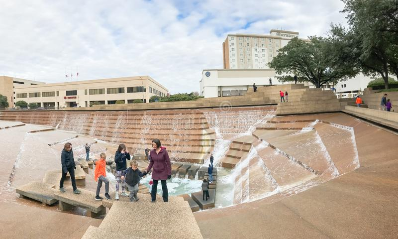 Water Gardens in downtown Fort Worth with visitors. FORT WORTH, TX, US-DEC 24, 2018:Water Gardens in downtown Fort Worth with visitors. A beautiful and stock photography