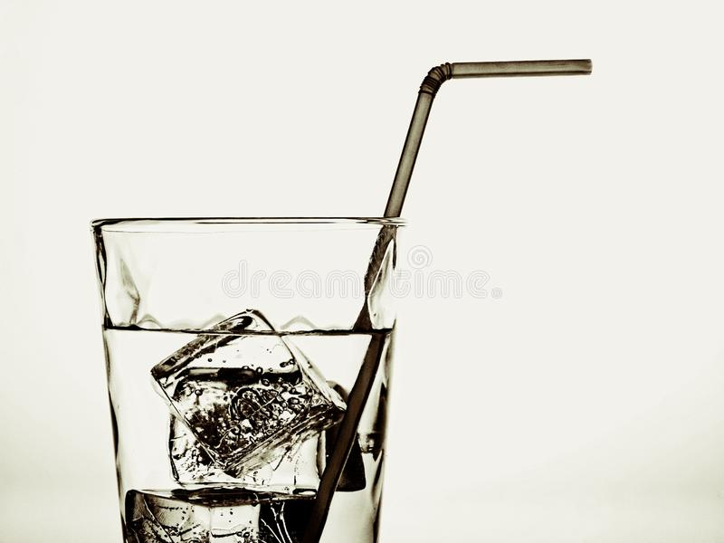 Water Glass,Ice Cubes & Straw stock photo