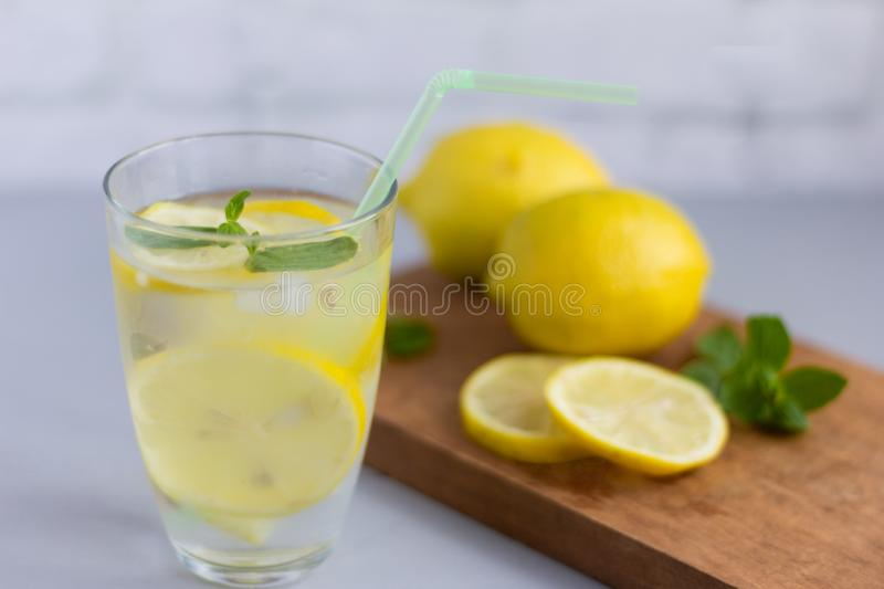 Water in a glass with lemon and oregano leaves,a refreshing soft drink to quench your thirst in the heat and maintain tone. / royalty free stock photo