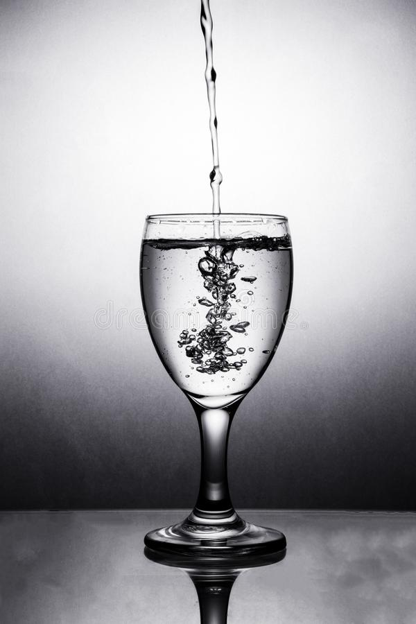 Water in glass with water splash stock images