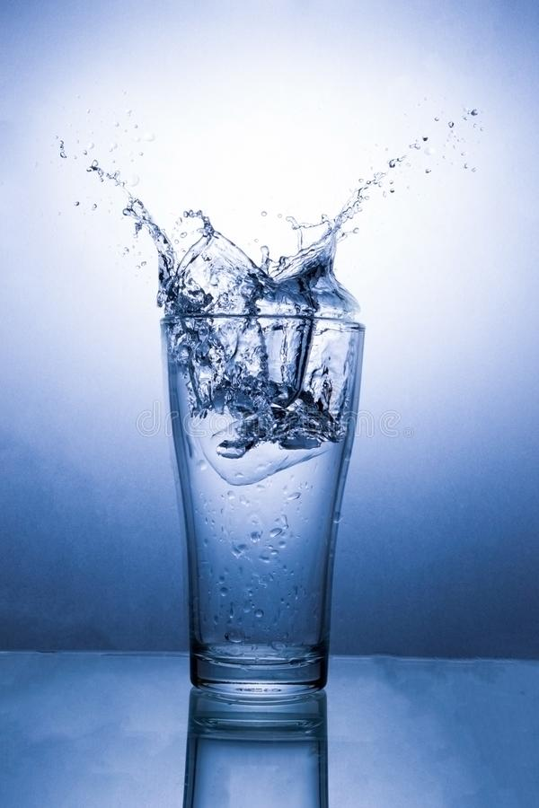 Water in glass with water splash royalty free stock photo
