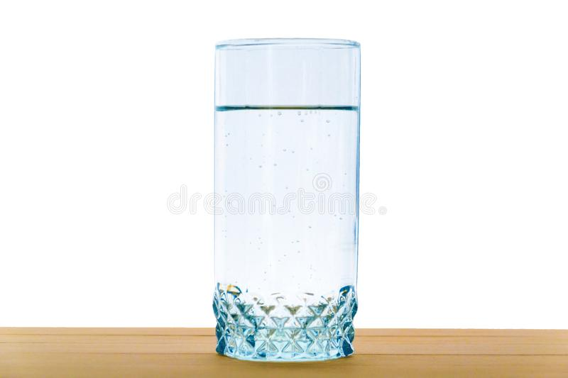 water glass on wood table isolated on white background stock images
