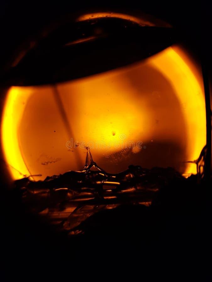 Water globe. Amber orbs ball stock photography