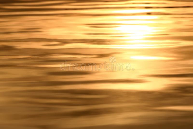 Water golden sunset background stock image