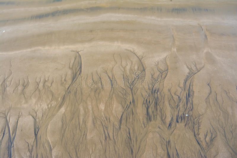 Water grooves in sand royalty free stock photo
