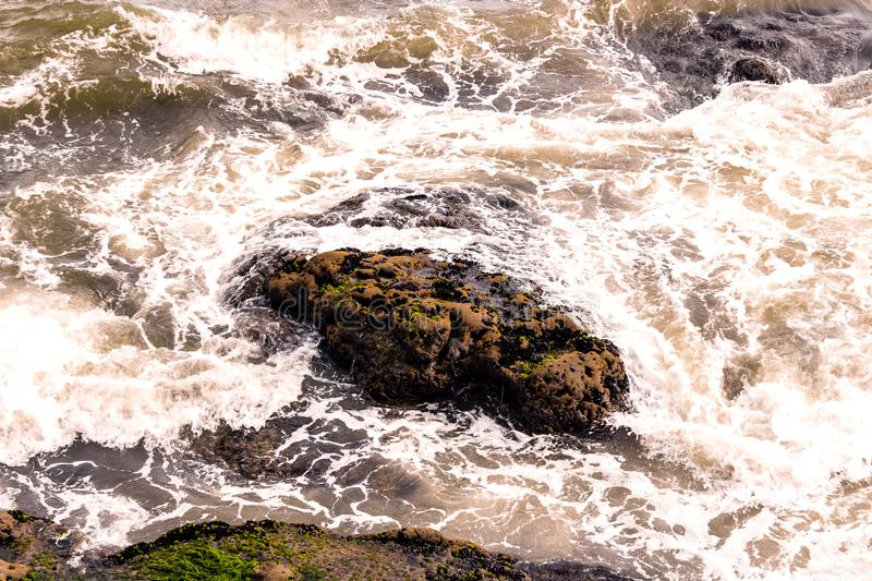 Water hitting the rock royalty free stock images