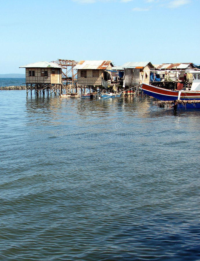 Water Houses. Slum Houses On Stilts Over Water stock images