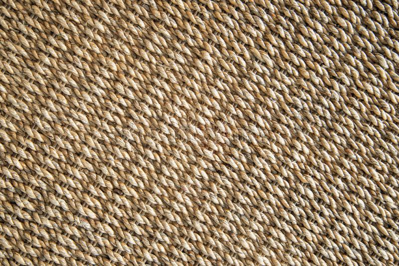 Water hyacinth wickerwork background. Top view of a beige color table made from natural water hyacinth. Closeup textured abstract background, pattern, style stock photo