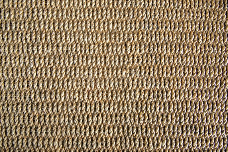 Water hyacinth wickerwork background. Top  view of a table made from natural water hyacinth.  Horizontal repeating pattern, brown color. Closeup abstract royalty free stock photography