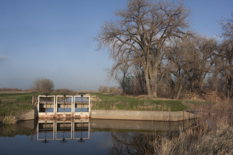Water irrigation channels in Colorado farmland royalty free stock photo