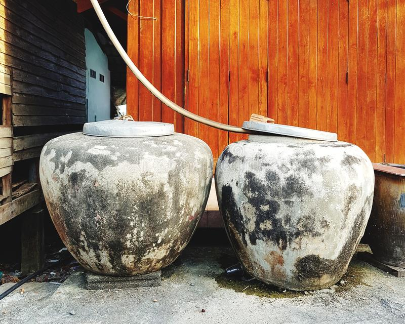 Water jars at rural house. Water jars rural house water-jar pot water-pot container food drink asia traditional countryside hogshead rural-house thailand old royalty free stock images