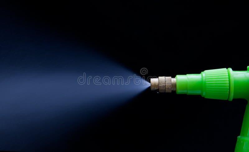 Water jet spray on black stock photos